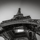 Eiffel tower in black and white during a sunny summer day