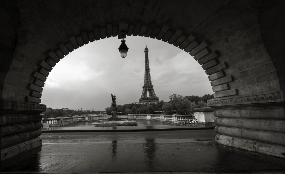 Black and white composition of eiffel tower with bridge forming frame Paris France